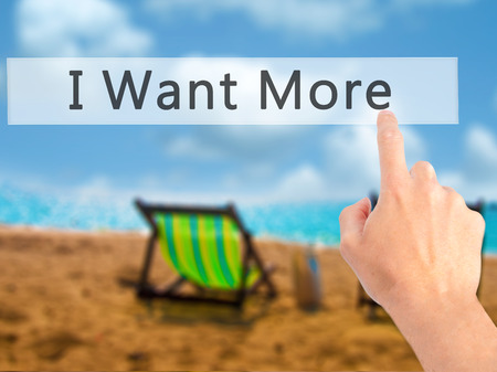 consumer rights: I Want More - Hand pressing a button on blurred background concept . Business, technology, internet concept. Stock Photo