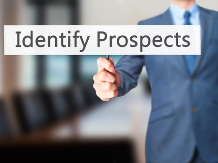 the prospects: Identify Prospects - Businessman hand holding sign. Business, technology, internet concept. Stock Photo