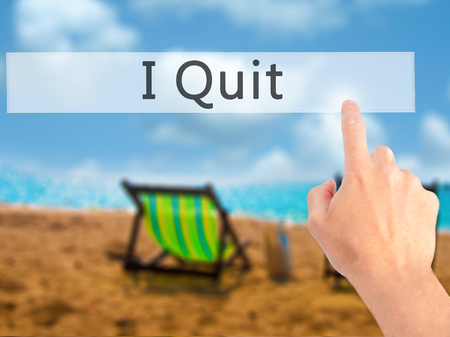 artistic addiction: I Quit - Hand pressing a button on blurred background concept . Business, technology, internet concept. Stock Photo