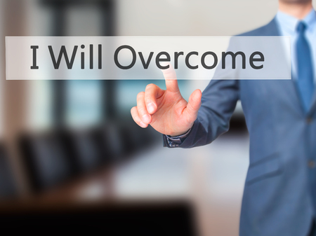 failed politics: I Will Overcome - Businessman hand pressing button on touch screen interface. Business, technology, internet concept. Stock Photo Stock Photo