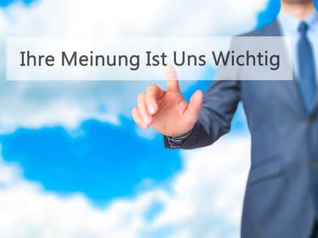 solicitation: Ihre Meinung Ist Uns Wichtig! (Your Opinion is Important to Us in German) - Businessman hand pressing button on touch screen interface. Business, technology, internet concept. Stock Photo Stock Photo