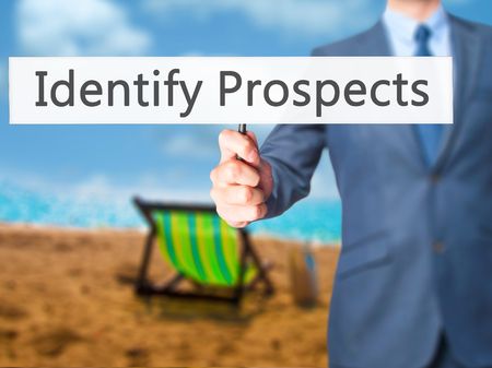 prospecting: Identify Prospects - Businessman hand holding sign. Business, technology, internet concept. Stock Photo