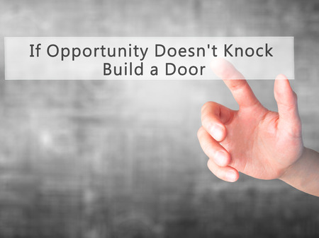 tocar la puerta: If Opportunity Doesnt Knock Build a Door - Hand pressing a button on blurred background concept . Business, technology, internet concept. Stock Photo