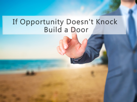 knock: If Opportunity Doesnt Knock Build a Door - Businessman hand pressing button on touch screen interface. Business, technology, internet concept. Stock Photo