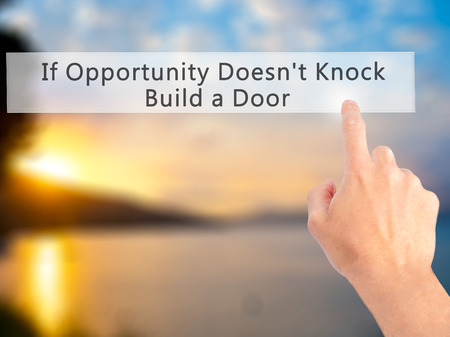 knock on door: If Opportunity Doesnt Knock Build a Door - Hand pressing a button on blurred background concept . Business, technology, internet concept. Stock Photo