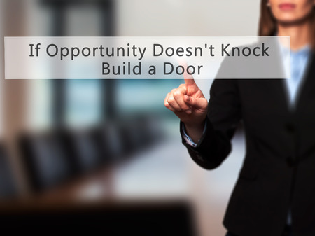 knock: If Opportunity Doesnt Knock Build a Door - Businesswoman hand pressing button on touch screen interface. Business, technology, internet concept. Stock Photo