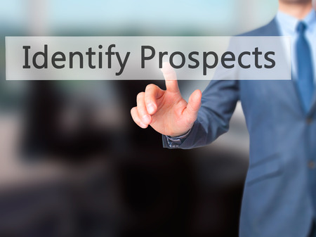 the prospects: Identify Prospects - Businessman hand pressing button on touch screen interface. Business, technology, internet concept. Stock Photo