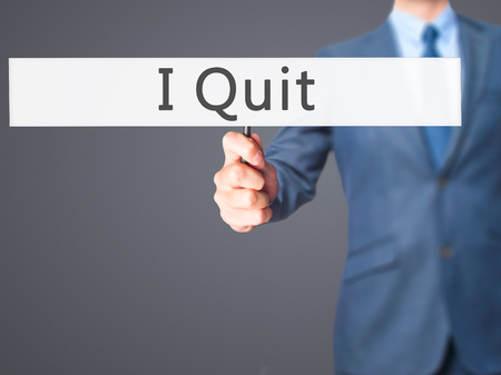 artistic addiction: I Quit - Businessman hand holding sign. Business, technology, internet concept. Stock Photo