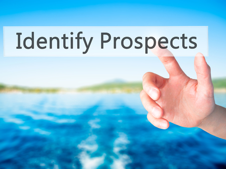 qualify: Identify Prospects  - Hand pressing a button on blurred background concept . Business, technology, internet concept. Stock Photo Stock Photo