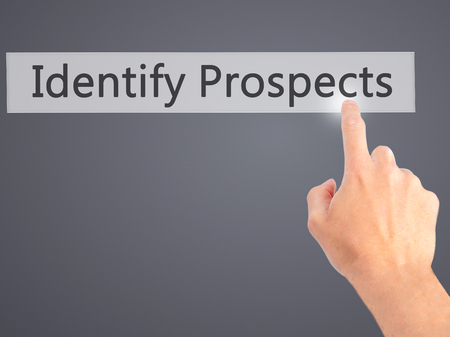 the prospects: Identify Prospects  - Hand pressing a button on blurred background concept . Business, technology, internet concept. Stock Photo Stock Photo