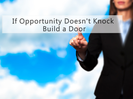 tocar la puerta: If Opportunity Doesnt Knock Build a Door - Businesswoman hand pressing button on touch screen interface. Business, technology, internet concept. Stock Photo