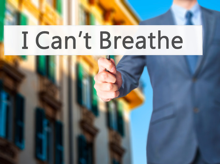 darren: I Cant Breathe - Businessman hand holding sign. Business, technology, internet concept. Stock Photo