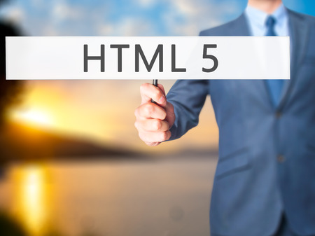 html 5: HTML 5 - Businessman hand holding sign. Business, technology, internet concept. Stock Photo Stock Photo