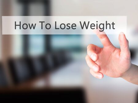 eating questions: How To Lose Weight - Hand pressing a button on blurred background concept . Business, technology, internet concept. Stock Photo