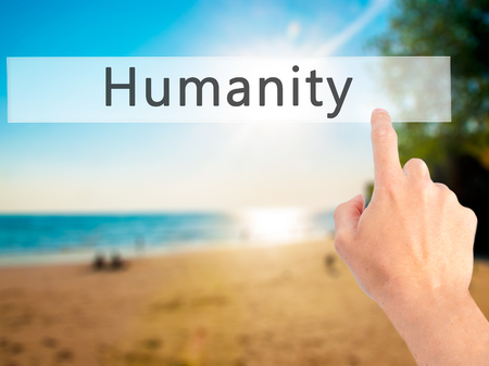 justness: Humanity - Hand pressing a button on blurred background concept . Business, technology, internet concept. Stock Photo