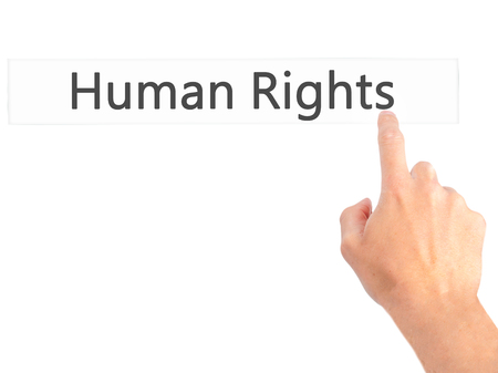 norms: Human Rights - Hand pressing a button on blurred background concept . Business, technology, internet concept. Stock Photo Stock Photo