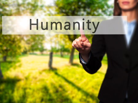 benevolence: Humanity - Businesswoman hand pressing button on touch screen interface. Business, technology, internet concept. Stock Photo Stock Photo