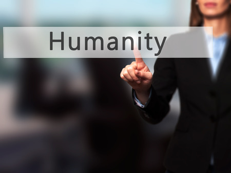 Humanity - Businesswoman hand pressing button on touch screen interface. Business, technology, internet concept. Stock Photo Stock Photo