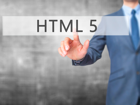 html 5: HTML 5 - Businessman hand pressing button on touch screen interface. Business, technology, internet concept. Stock Photo Stock Photo