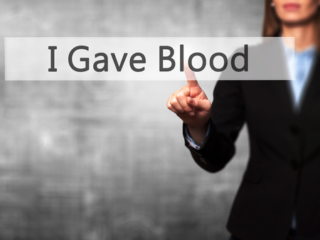 gave: I Gave Blood - Businesswoman hand pressing button on touch screen interface. Business, technology, internet concept. Stock Photo