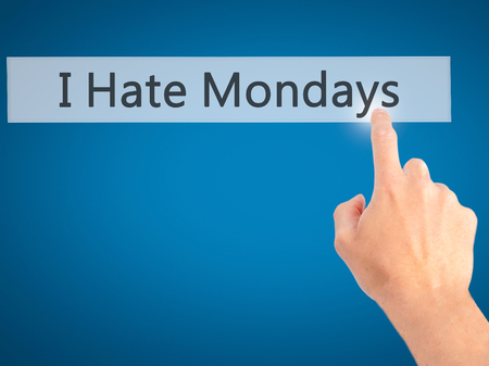 I Hate Mondays - Hand pressing a button on blurred background concept . Business, technology, internet concept. Stock Photo