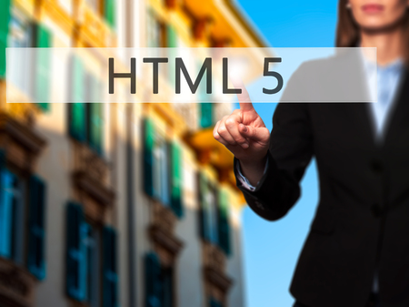 html 5: HTML 5 - Businesswoman hand pressing button on touch screen interface. Business, technology, internet concept. Stock Photo