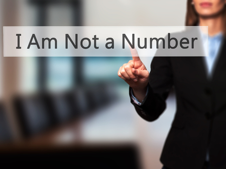 consumer rights: I Am Not a Number - Businesswoman hand pressing button on touch screen interface. Business, technology, internet concept. Stock Photo