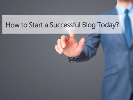differentiation: How to Start a Successful Blog Today - Businessman hand pressing button on touch screen interface. Business, technology, internet concept. Stock Photo