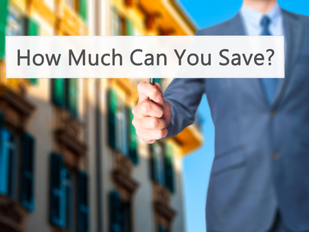 budgetary: How Much Can You Save - Businessman hand holding sign. Business, technology, internet concept. Stock Photo