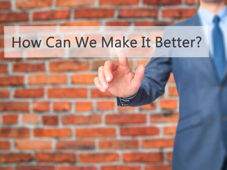 better button: How Can We Make It Better - Businessman hand pressing button on touch screen interface. Business, technology, internet concept. Stock Photo