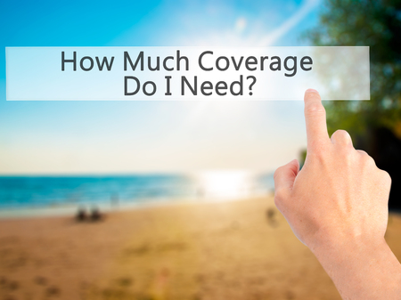 coverage: How Much Coverage Do I Need - Hand pressing a button on blurred background concept . Business, technology, internet concept. Stock Photo