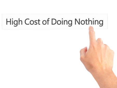 high cost: High Cost of Doing Nothing - Hand pressing a button on blurred background concept . Business, technology, internet concept. Stock Photo Stock Photo