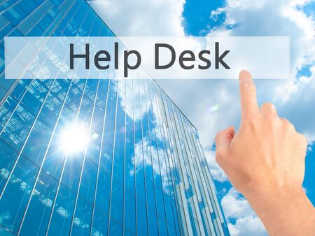 Help Desk - Hand pressing a button on blurred background concept . Business, technology, internet concept. Stock Photo Stock Photo