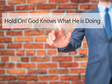 god button: Hold On God Knows What He is Doing - Businessman hand pressing button on touch screen interface. Business, technology, internet concept. Stock Photo