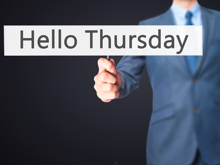 the thursday: Hello Thursday - Businessman hand holding sign. Business, technology, internet concept. Stock Photo