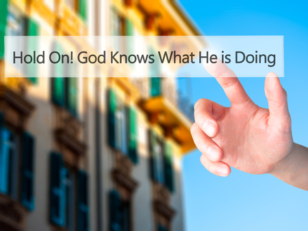 he: Hold On God Knows What He is Doing - Hand pressing a button on blurred background concept . Business, technology, internet concept. Stock Photo