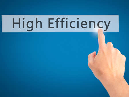 efficacy: High Efficiency - Hand pressing a button on blurred background concept . Business, technology, internet concept. Stock Photo Stock Photo