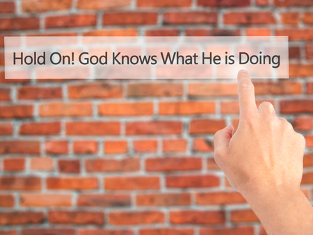 Hold On God Knows What He is Doing - Hand pressing a button on blurred background concept . Business, technology, internet concept. Stock Photo