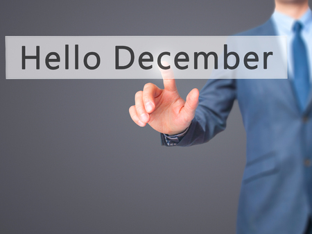 january 1: Hello December - Businessman hand pressing button on touch screen interface. Business, technology, internet concept. Stock Photo Stock Photo