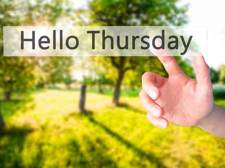 thursday: Hello Thursday - Hand pressing a button on blurred background concept . Business, technology, internet concept. Stock Photo Stock Photo