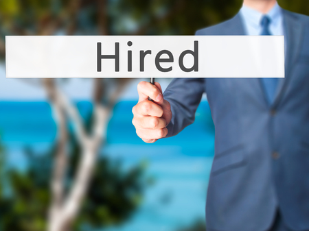 recruit help: Hired - Businessman hand holding sign. Business, technology, internet concept. Stock Photo Stock Photo