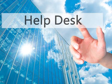 service desk: Help Desk - Hand pressing a button on blurred background concept . Business, technology, internet concept. Stock Photo Stock Photo