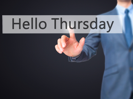 the thursday: Hello Thursday - Businessman hand pressing button on touch screen interface. Business, technology, internet concept. Stock Photo