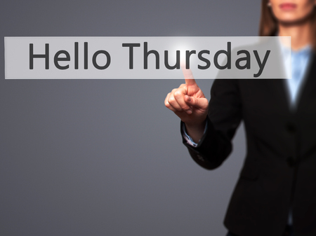 thursday: Hello Thursday - Businesswoman hand pressing button on touch screen interface. Business, technology, internet concept. Stock Photo Stock Photo