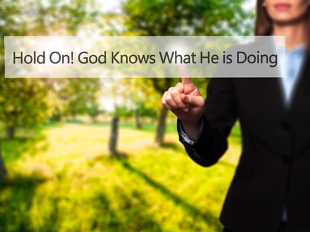 god button: Hold On God Knows What He is Doing - Businesswoman hand pressing button on touch screen interface. Business, technology, internet concept. Stock Photo
