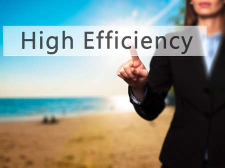 efficacy: High Efficiency - Businesswoman hand pressing button on touch screen interface. Business, technology, internet concept. Stock Photo Stock Photo