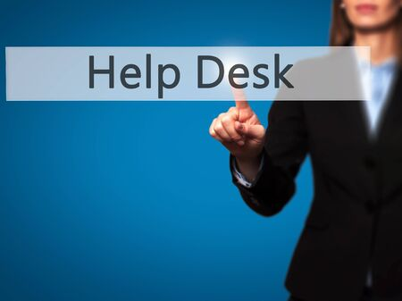 virtual assistant: Help Desk - Businesswoman hand pressing button on touch screen interface. Business, technology, internet concept. Stock Photo