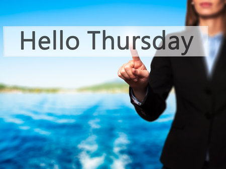 the thursday: Hello Thursday - Businesswoman hand pressing button on touch screen interface. Business, technology, internet concept. Stock Photo Stock Photo