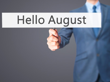 hi back: Hello August - Businessman hand holding sign. Business, technology, internet concept. Stock Photo