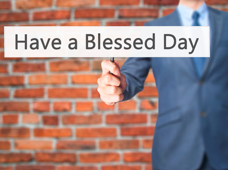 think through: Have a Blessed Day - Businessman hand holding sign. Business, technology, internet concept. Stock Photo Stock Photo